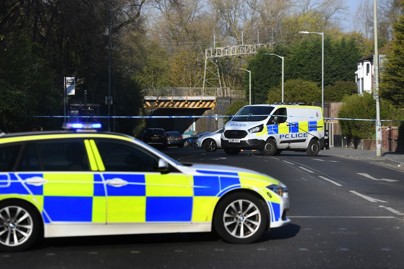 Police at the scene of a fatal crash on Wellington Road North, Stockport