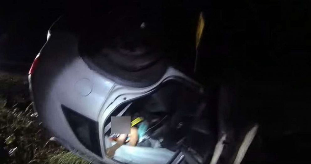 Video captures hero cop single-handedly lift overturned car off woman to save her life